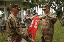The Honolulu District-based 565th Engineer Detachment, Forward Engineer Support Team-Advance (FEST-A) held a Deployment Casing Ceremony April 24 at Fort Shafter's Palm Circle to mark its official deployment to support Operation Enduring Freedom in Afghanistan. In this photo 565th ENG DET Commander Maj. William Hannan (center left), Mike Bruse and Sgt. 1st Class Gary Malkin case the detachment guidon.