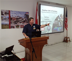 Dustin Tellinghuisen, from U.S. Army Corps of Engineers Buffalo District, answers a question during the 2013 Indonesia Urban Search & Rescue Workshop. The U.S. Pacific Command sponsored the three-day workshop, which was conducted in partnership with the Government of Indonesia. The U.S. instruction team, which was comprised of subject matter experts from the U.S. Army Corps of Engineers, University of Wyoming, and Texas A&M University, helped to raise awareness about structural engineering in urban search and rescue missions by demonstrating techniques and sharing best practices used in the U.S. and around the world.